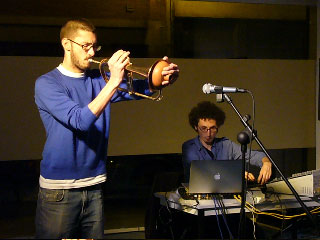 Scene of trumpets with a laptop in a room
